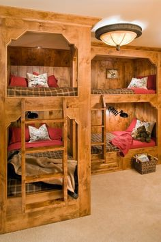 I love the idea of multiple bunk beds in a finished basement ... You can have multiple guests over without needing air mattresses or cots. Reminds me of college ...