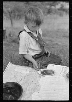 Untitled photo, possibly related to: Son of white migrant eating lunch of blackberry pie along the highway east of Fort Gibson, Oklahoma. 1939 June. Library of Congress.
