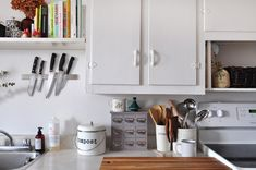 That magnetic knife holder that everyone has in their kitchens isn't just for holding knives. Here, we show some genius storage uses.