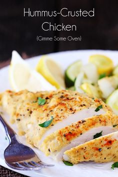 hummus-crusted chicken...baked on a bed of zucchini and yellow squash (add more seasoning to veggies) ++