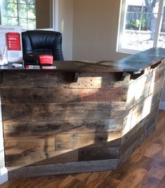 Reclaimed barn wood front desk, custom built for my State Farm office in Templeton, CA. Andrew Berry from Phoenix construction designed it and I absolutely love it!