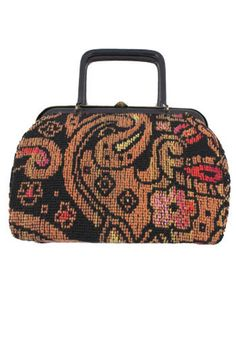 f11d517a752e This vintage frame purse is a petite version of the carpet bag style