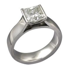 Modern Cathedral Engagement Ring - This modern engagement ring's center stone is boldly raised above the band in a cathedral  style. The clean lines and bold styling create a striking ring. The  bezel setting has a deep V cutout and comes to a dramatic point that  can be viewed through the cathedral window. 5 mm wide. - This designer engagement ring is set with a princess-cut diamond.