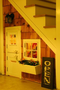 I love this idea! A playhouse under your stairs! :)
