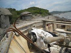 A fisherman boat and the Albanian defense    bunker of communist era