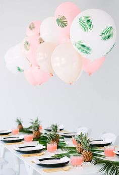 Add some tropical vibes to your baby shower with pineapples and palm leaves. This chic baby shower is filled with beautiful pinks and greens. Click here for more adorable spring baby shower ideas.