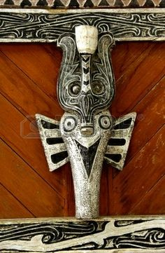 View of a detail of a Batak house ornament in Sumatra. Geometrical lines for the representation of a traditional mask photo Southeast Asian Arts, East Indies, House Ornaments, East Side, Traditional House, Masks, Carving, Stock Photos, Patterns