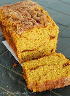 Every slice of this cinnamon swirl pumpkin bread is filled with fall goodness. A ribbon of cinnamon sugar makes this pumpkin bread absolutely scrumptious! #pumpkinbread #pumpkinquickbread #pumpkincinnamonbread #pumpkinspicebread #pumpkincinnamonswirlbread #creationsbykara Fall Desserts, Delicious Desserts, Yummy Food, Barre Energie, Baking Recipes, Dessert Recipes, Bread Recipes, Recipes Dinner, Pumpkin Spice Bread