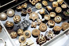 A whole tray of Coco Chanel earrings