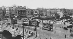 Old Dublin street scenes, Ireland images of O'Connell Bridge trams & traffic, Guinness barge on River Liffey video, Dublin city photographs Dublin Street, Dublin City, Old Images, Old Photos, Vintage Photos, Images Of Ireland, Scene Photo, Dublin Ireland, Book Of Life