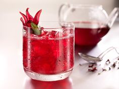 Skyy Vodka Hibiscus Cocktail:   2 ounces SKYY Infusions Coconut  2 ounces chilled hibiscus tea  1/2 ounce lime juice  Lime for garnish  Mix and serve on the rocks.