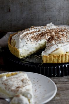 Banana Cream Pie - -  Creamy, custardy filling flavoured with ripe bananas on a crisp, shortcrust pastry base topped with lashings of whipped cream. And none of that instant pudding stuff here, this is made from scratch and it might not be the easiest banana cream pie recipe, but it's so worth it.