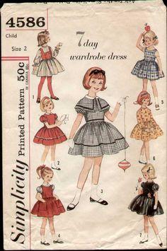 vintage 1962 seven day wardrobe of dresses for a little girl, school dresses, Sunday school, etc.