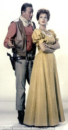 Hardly a gushing romantic: John Wayne with co-star Maureen O'Hara, with whom he…                                                                                                                                                                                 More