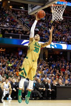 6b76c21bf430 Zach Auguste  30 of the Notre Dame Fighting Irish shoots against the  Kentucky Wildcats in