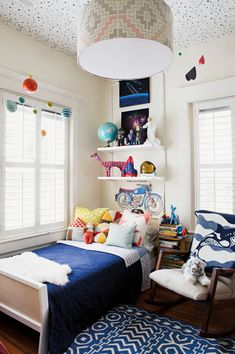 fun blue / white kids room with wallpaper on the ceiling