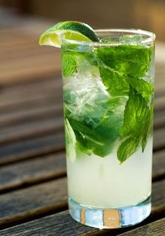 Mojito: 10 fresh mint leaves lime, cut into 4 wedges 2 tablespoons white sugar, or to taste 1 cup ice cubes 1 fluid ounces white rum cup club soda Summer Cocktails, Cocktail Drinks, Cocktail Recipes, Alcoholic Drinks, Beverages, Cocktail List, Healthy Cocktails, Bacardi Rum, Mojito Recipe