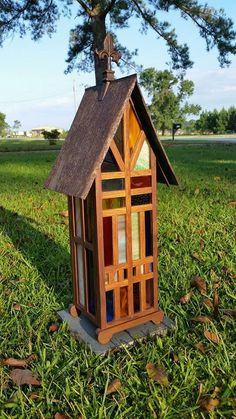 Stained glass birdhouse by Recycling is for the Birds on facebook.... these colors make me happy <3