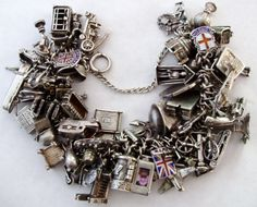 Vintage London WWII sterling bracelet I would love to sit and go over each and every charm in this bracelet! How fasinating! Vintage Charm Bracelet, Silver Charm Bracelet, Charm Jewelry, Silver Charms, Vintage Jewelry, Charm Bracelets, Pink Jewelry, Jewelry Dish, Silver Earrings