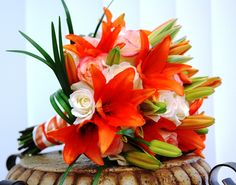 Bridal bouquet with orange stargazer lillies, roses and grasses