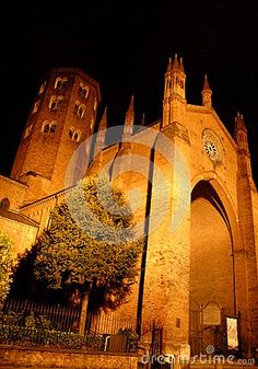 Photo taken at night in Piacenza (Italy). Piacenza is capital of the province of Emilia-Romagna. It is nicknamed the Firstborn in 1848 because it was the first Italian city to vote in a plebiscite for annexation to the Kingdom of Sardinia. On the border between Emilia and Lombardy, influenced by economic and cultural center of Milan. In the picture you see the Basilica of St. Anthony with a tree next to the entrance lit from the bottom up.