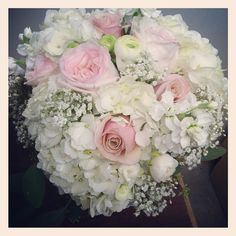 Hydrangeas, ranunculus, stock, blush garden roses, pink roses & babies breath.