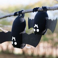Spook out trick-or-treaters with a bat craft that's more fun than frightening! (The bodies are made of stuffed black socks.)