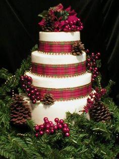 Four tier fondant Christmas cake with plaid ribbon.