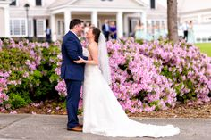 Beautiful first look with couple in front of pink flowers