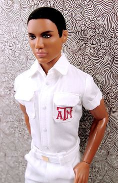 Nice quality Texas A & M shirt with collar, flap pockets, buttons, cuffs and A & M Texas logo. Fastens under crotch to keep it looking pressed when worn. Should fit all Ken dolls