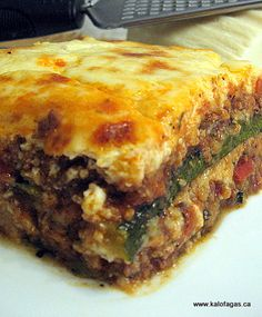 Moussaka- with zucchini instead of eggplant. my favorite dish. To bad we don't have food like that in cc. Moussaka- with zucchini instead of eggplant. my favorite dish. To bad we don't have food like that in cc. Eggplant Zucchini, Kolaci I Torte, Egyptian Food, Greek Cooking, Greek Dishes, Greek Recipes, Greek Meals, Mediterranean Recipes, Gratin