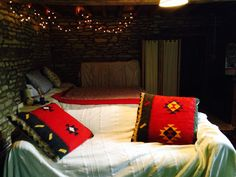 The sofa and double bed in our Rustic Barn Studio Let.