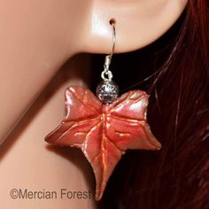 Welcome to our listing for a simple, yet elegant pair of Ivy Leaf Earrings in Late Autumn Tones.  Hand Sculpted from Polymer Clay, Hand Painted to give depth and detail and finished with a Pentacle bead just below a Sterling Silver Earring Hook.  As our Polymer Clay items are made by our own fair hands we are able to customise each piece to fit your requirements. If you would like a different colour or alterations made to the design we are happy to do this, free of charge. Simply drop us a… Pagan Jewelry, Fall Jewelry, Late Autumn, Ivy Leaf, Pentacle, Leaf Earrings, Wiccan, Different Colors, Belly Button Rings