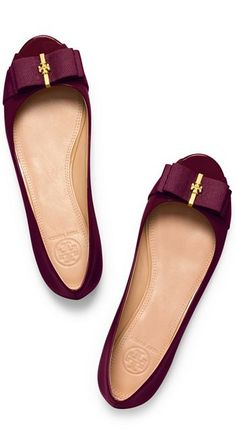 Cranberry bow flats by Tory Burch http://www.revolvechic.com/#!flats/c1xxn