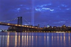 The Tribute in Lights is illuminated next to the Statue of Liberty (C) and One World Trade Center (L) during events marking the 10th anniversary of the 9/11 attacks on the World Trade Center in New York, September 10, 2011. REUTERS/Gary Hershorn