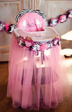 Kris this would be cute for P's first bday!  tutu for high chair for first birthday party maybe! I love this only i think id ro like purple and pink?