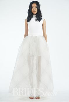 Brides.com: . Trend: Sheer Skirts. High neck sleeveless mohair top with a metallic plaid tulle skirt, Houghton