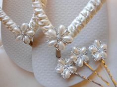 Ivory Bridal Flip Flops embellished with Pearl Rhinestone flower and matching hair pins.