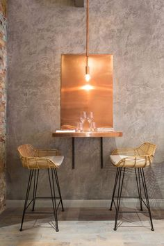 perfection! bent copper table + fiber stools | restaurant design