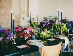 Navy candlesticks - so chic! | Jewel Tone Wedding Florals That Really Rock via @IBTblog