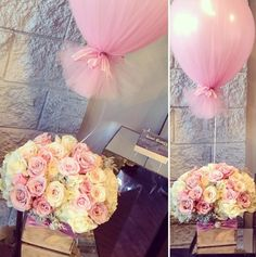 Centerpiece: assortment of white and pink roses w/ a colored ballon tied and wrapped with tulle of the same color (IG: avant_garden)