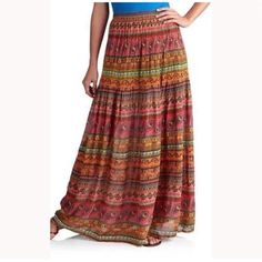 Planet gold skirt Planet gold paisley maxi skirt juniors size M . Material : Rayon  color is the second pic ( first pic is for the model) Planet gold  Skirts Maxi