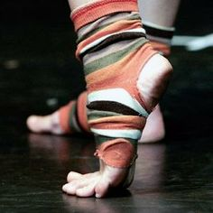 Find a pair of awesome patterned worn out socks, cut the toe and the heal... dance socks!