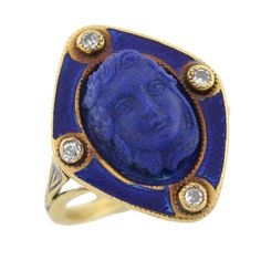 Victorian Carved Lapis Cameo, Diamond & Enamel Ring. An exquisite carved lapis ring from the Victorian (ca1880) era! Made of 14kt yellow gold, the piece has a beautiful lapis set in the center of a complentary blue enameled frame. The lapis has a absolutely gorgeous hand carved cameo image of the face of a woman with soft facial features, flowing hair and 3 flowers at the side of her face. The blue enameled frame encircles the face and compliments the rich blue color of the lapis.
