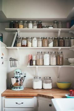 I'd like this simple setup for my kitchen.  Just using finished plywood for the cabinet spaces...and all those nifty mason jars for the flour and other baking ingredients (not to mention this lovely kitchenaid in mint) Heart!