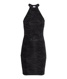 30 Fitted, sleeveless dress in jersey with metallic threads and a glittery printed pattern. Seam at waist, open back, and neckline with hook-and-eye fastener at back of neck. Bodice lined at front.