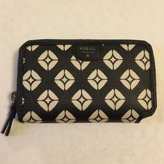 Fossil Black & White Geo Pattern Small Wallet ID Overall wallet is in good condition, the stitching where the ID fits came apart alittle- but still works! Beautiful wallet! Fossil Bags Wallets