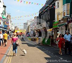 People strolling along the lanes in Brighton on a sunny day.