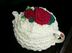 Rose Top Cream Cake Tea Cosy -- Mar 2015 I made this in pale cream, with one med pink rose on top then 2 shades of pink small daisy flowers around the rose, with leaves - SM
