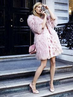 Fur, floral dress, tiny bag, and heels: all pink! And a camera.